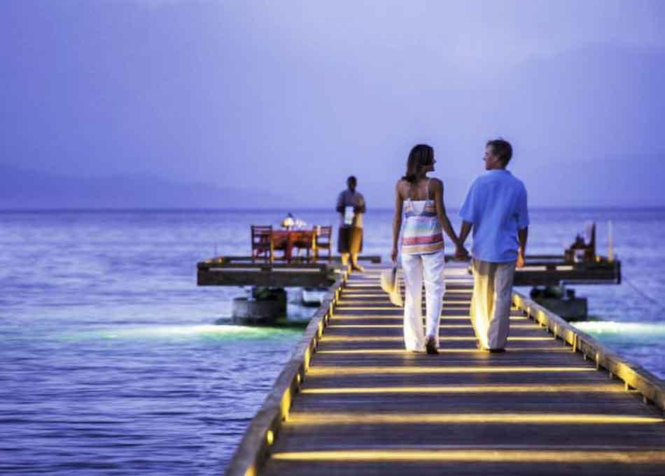 Couple on boardwalk in Fiji