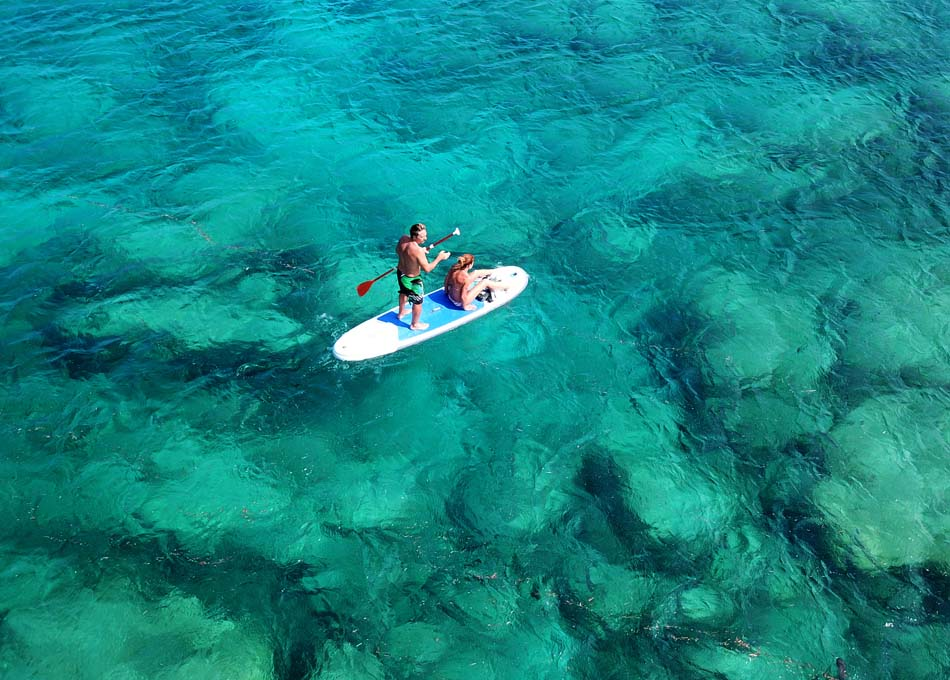 Couple practicing Stand Up Paddle in Fiji